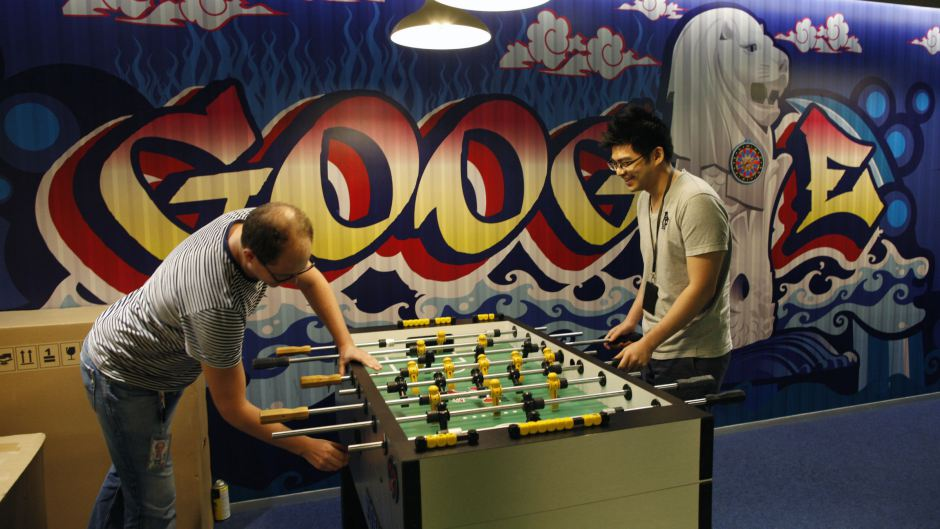 Google Communications Manager Robin Moroney (left) playing Foosball with an employee.