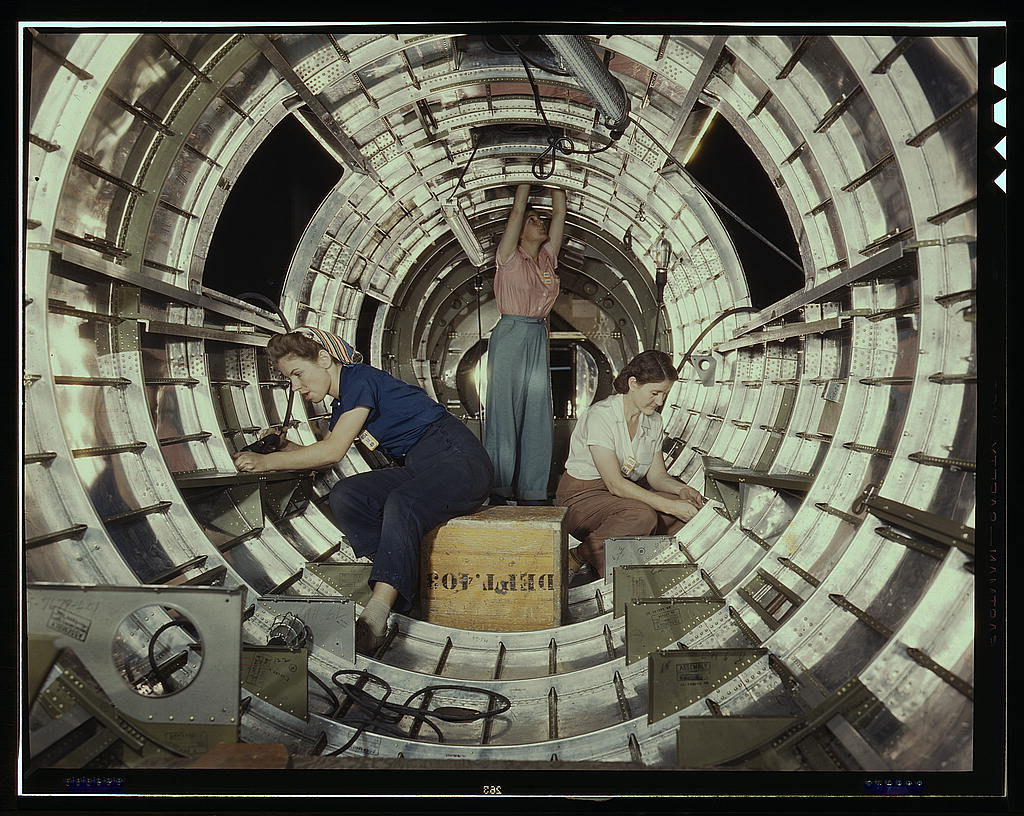 """""""Women workers install fixtures and assemblies to a tail fuselage section of a B-17 bomber at the Douglas Aircraft Company plant, Long Beach, Calif. Better known as the """"Flying Fortress,"""" the B-17F is a later model of the B-17, which distinguished itself i"""" flickr photo by The Library of Congress https://flickr.com/photos/library_of_congress/2179922684 shared with no copyright restriction (Flickr Commons)"""