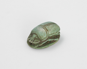image displaying a small scarab beetle sculpture