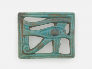 image showing a rectangular amulet sculpture carved into the shape of the Eye of Horus