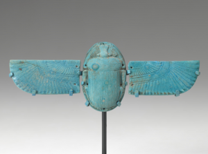 image of a blue-colored scarab sculpture with attached wings