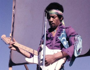 You can see how Jimi has the guitar flipped around in this picture. This is how he always played guitar.