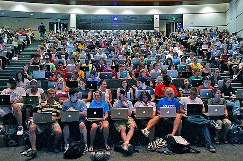 Students in a large lecture hall.