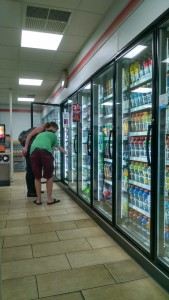 Two 7-11 customers shop for beverages Wednesday night.