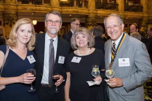 Dr. Melissa Moeller, Dr. Frederick Moeller, Mary Macrina and Dr. Frank Macrina pose for a photo at the Investiture Dinner on Oct. 22