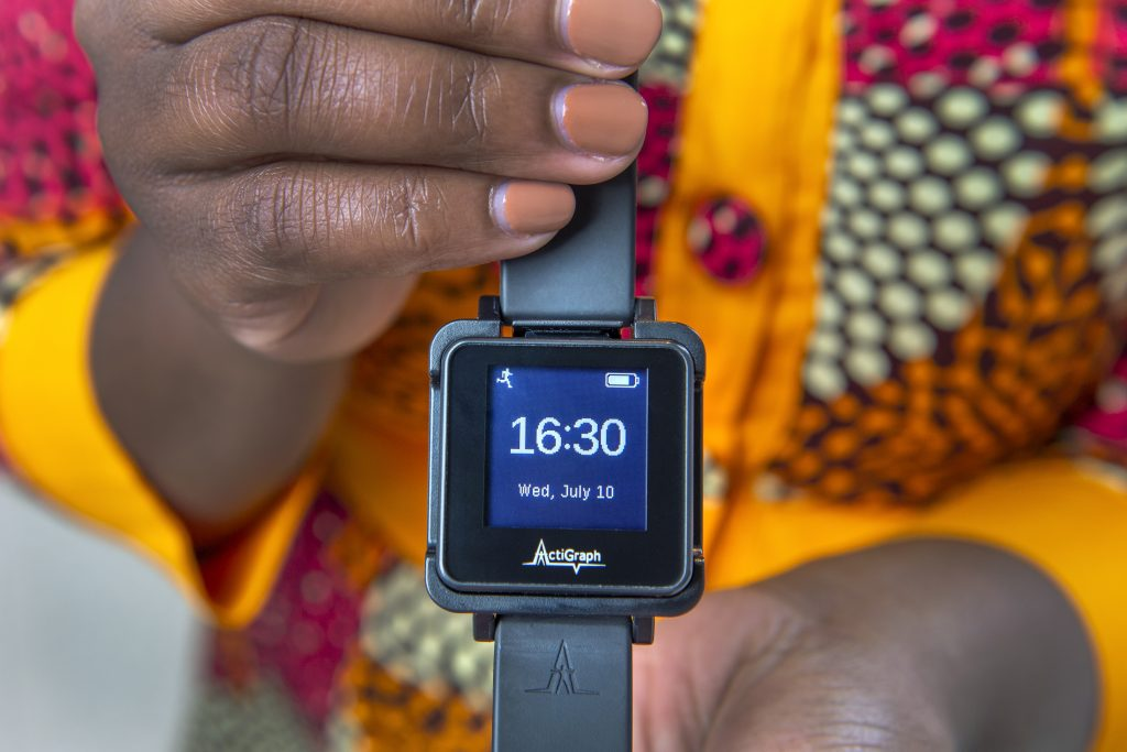 Dr. Agyemang holds the motion biosensor watch