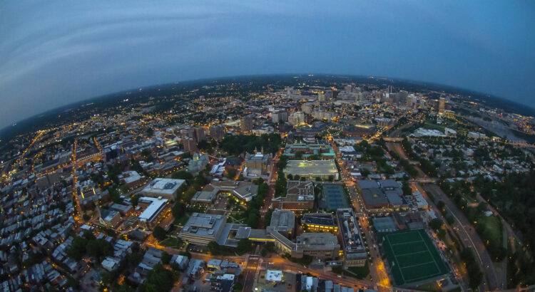 Aerial photography of VCU's Monroe Park campus and downtown Richmond, VA at night time.