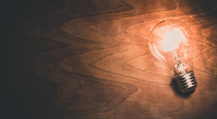 lightbulb on a wood surface